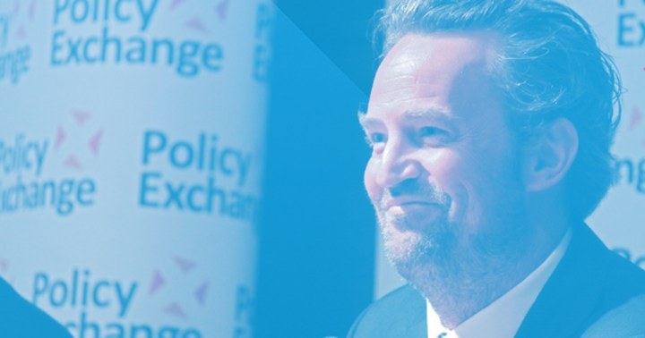 Matthew Perry smiling at Policy Exchange for Drug Courts